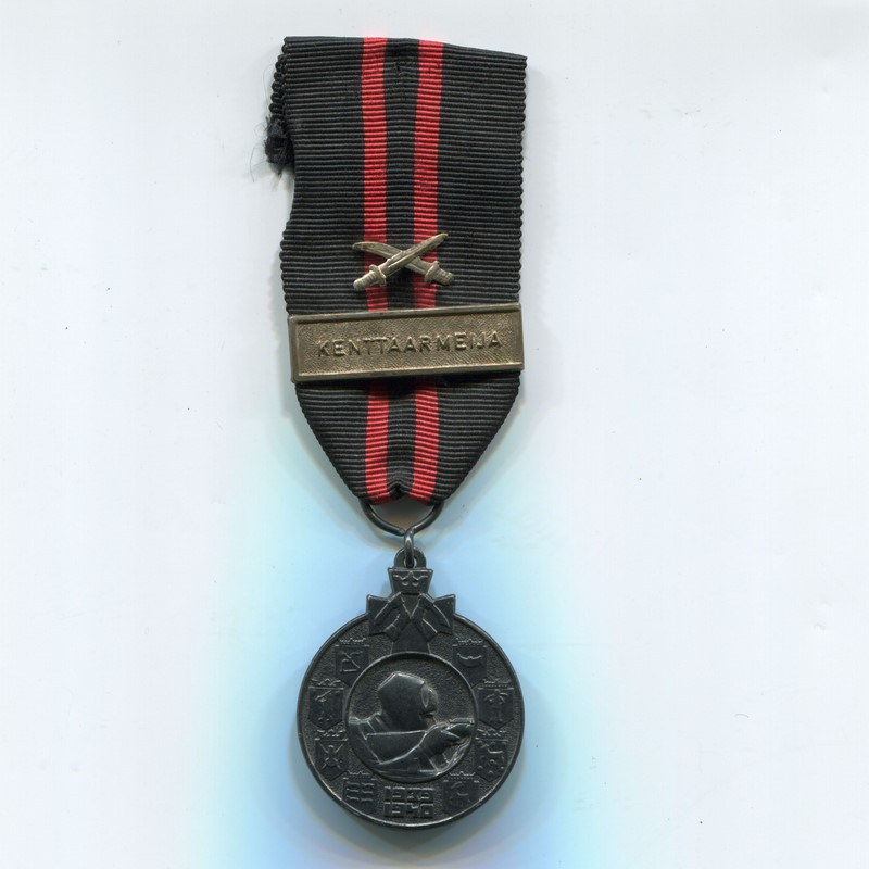 Militaria Barcelona Finland. Medal of the Winter War against the USSR 1939-1940. With Kenttäarmeija pin and two swords Ribbon
