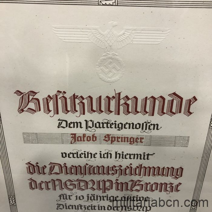 Germany III Reich. Bronze NSDAP Long Service Medal Award for 10 Years of Service. Awarded on January 30, 1942 to the Gauleiter of Hesse Jakob Springer, prosecuted in the process against the Euthanasia Center of Hadamar, NS-Tötungsanstalt Hadamar, in Hessen