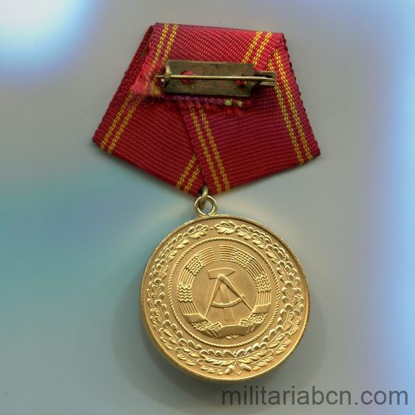 DDR GDR German Democratic Republic. Medal for Good Service in the Militarized organs of the Ministry of the Interior. Gold version. 25 years. Medaille für Treue Dienste in den bewaffneten Organen des Ministeriums des Innern ribbon back