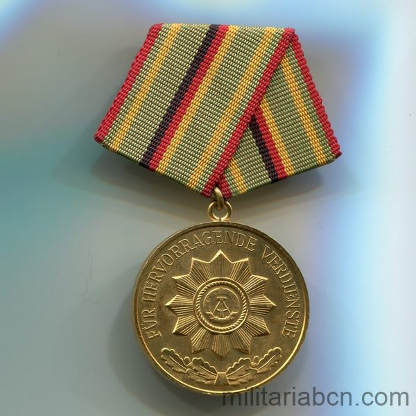 DDR Medal of Merit of Organs of the Ministry of the Interior. Gold version. Verdienstmedaille der Organe des Ministeriums des Innern ribbon
